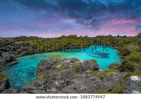 Sunset at Danau Weekuri in Sumba Island, Indonesia. Famous travel destinations. Royalty-Free Stock Photo #1883774947