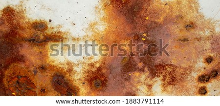 texture of rusty iron, cracked paint on an old metallic surface, sheet of rusty metal with cracked and flaky paint, corrosion, decay metal background, decay steel, decay Royalty-Free Stock Photo #1883791114