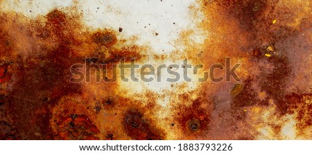 texture of rusty iron, cracked paint on an old metallic surface, sheet of rusty metal with cracked and flaky paint, corrosion, decay metal background, decay steel, decay Royalty-Free Stock Photo #1883793226