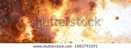 texture of rusty iron, cracked paint on an old metallic surface, sheet of rusty metal with cracked and flaky paint, corrosion, decay metal background, decay steel, decay Royalty-Free Stock Photo #1883793391