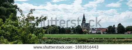 View of dutch white little town Thorn, province of Limburg, Netherlands. The Saint Michaels church or Abbey Church of 'Thorn', Roman Catholic church from the 14th century. Banner