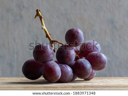 bunch of red grapes  on the stalk Royalty-Free Stock Photo #1883971348