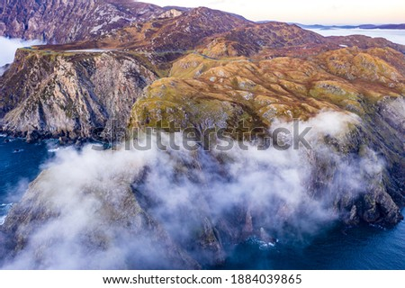 Dramatic aerial view of the Slieve League cliffs in County Donegal, Ireland. Royalty-Free Stock Photo #1884039865