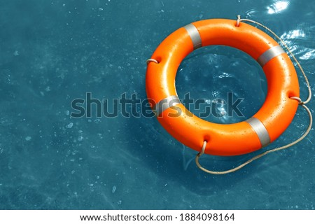 Orange life buoy floating in sea, above view. Emergency rescue equipment Royalty-Free Stock Photo #1884098164