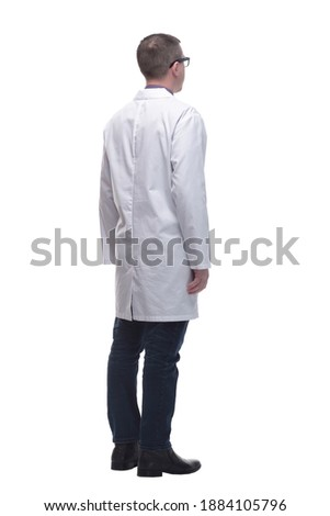 Rear view of medical doctor, full length portrait Royalty-Free Stock Photo #1884105796