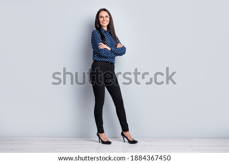 Full length body size profile side view of charming content tall cheerful lady folded arms isolated on grey pastel color background Royalty-Free Stock Photo #1884367450