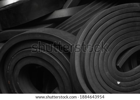 Close-up rubber sealing strips for waterproof doors. A pile of rubber twisted into rolls. Royalty-Free Stock Photo #1884643954