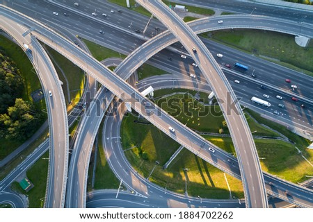 A modern flyover road junction in a large megapolis Royalty-Free Stock Photo #1884702262