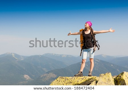 hiker at the top with backpack enjoy sunny day  #188472404