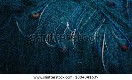 rustic fishing net with buoys and ropes Royalty-Free Stock Photo #1884841639