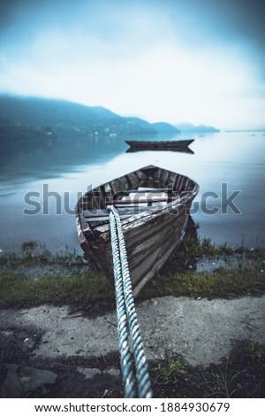 Pokhara is a popular destination for enjoying boat rides. Paddleboat, a kayak, sailboat or a rowboat or available to enjoy lake the lake.  #1884930679