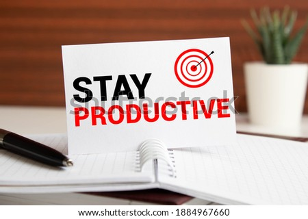 Word writing Stay Productive in the office with surroundings such as laptop marker pen stationery coffee Business concept for Concentration Efficiency Productivity Workshop background space Royalty-Free Stock Photo #1884967660