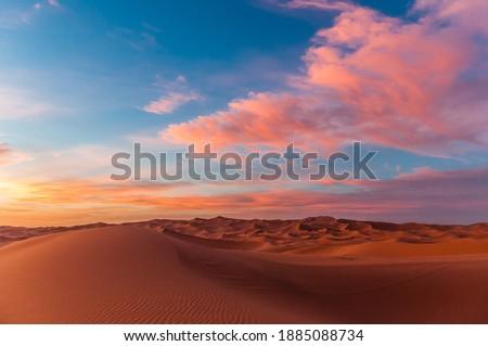 Sunset over the Sahara near Merzouga (Erg Chebbi), Morocco Royalty-Free Stock Photo #1885088734