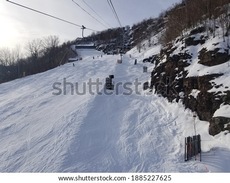Hunter Mountain Ski Resort with snow as viewed from a chairlift Royalty-Free Stock Photo #1885227625