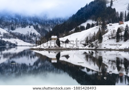 Beautiful winter landscapes along the shores of the Wagital lake in the idyllic pre-alps region of the Schwyz canton, Central Switzerland Royalty-Free Stock Photo #1885428493