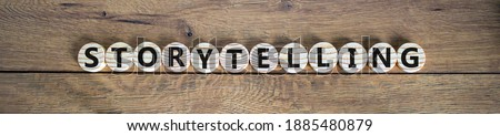 Storytelling symbol. Wooden small wooden circles with word 'storytelling' on a beautiful wooden background. Business and success storytelling concept.