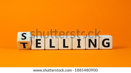 Selling or telling symbol. Turned wooden cubes and changed the word 'telling' to 'selling'. Beautiful orange background, copy space. Business and storytelling selling or telling concept. Royalty-Free Stock Photo #1885480900