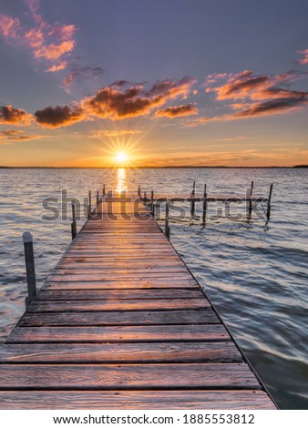 the wooden pier at sunset Royalty-Free Stock Photo #1885553812