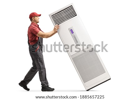 Full length profile shot of a repairman with a portable self standing air conditioning device isolated on white background Royalty-Free Stock Photo #1885657225