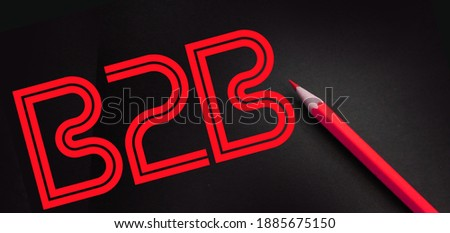 B2B abbreviation yellow on black lettering and yellow pencil besides. Business to business concept.