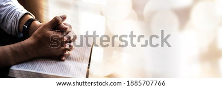 Man hands pray on bible. Concept of hope, faith, christianity, religion, church online. Royalty-Free Stock Photo #1885707766
