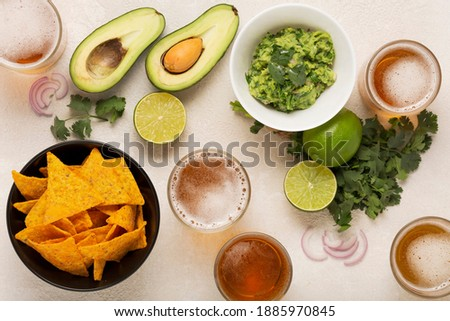 light Mexican snack or dinner Guacamole, corn chips and beer,