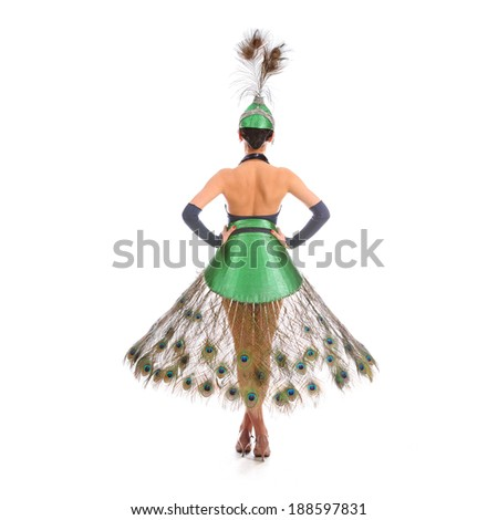 Burlesque dancer with peacock feathers and green dress  #188597831
