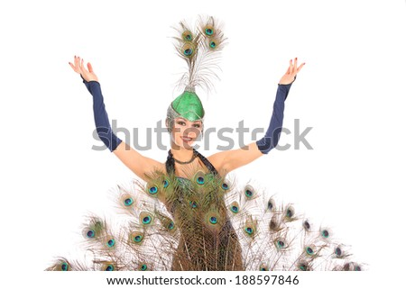 Burlesque dancer with peacock feathers and green dress  #188597846