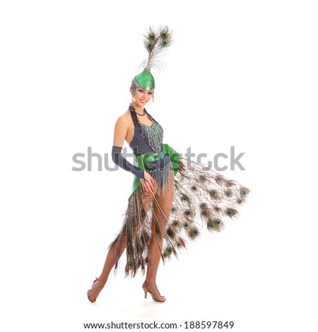 Burlesque dancer with peacock feathers and green dress  #188597849