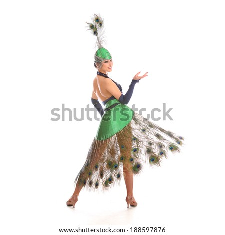 Burlesque dancer with peacock feathers and green dress  #188597876