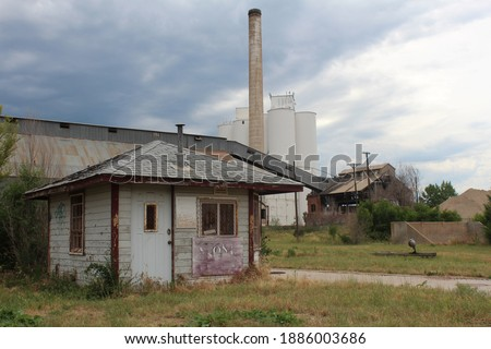 Old sugar beet factory abandoned.  Derelict building in Loveland, CO.  Condemned factory in shambles. Royalty-Free Stock Photo #1886003686
