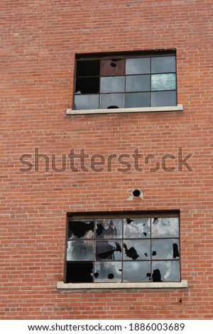 Old sugar beet factory abandoned.  Derelict building in Loveland, CO.  Condemned factory in shambles. Royalty-Free Stock Photo #1886003689