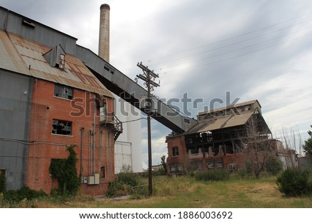 Old sugar beet factory abandoned.  Derelict building in Loveland, CO.  Condemned factory in shambles. Royalty-Free Stock Photo #1886003692
