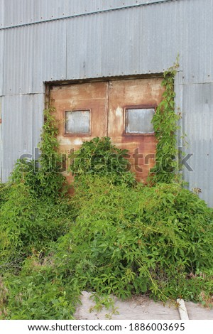 Old sugar beet factory abandoned.  Derelict building in Loveland, CO.  Condemned factory in shambles. Royalty-Free Stock Photo #1886003695