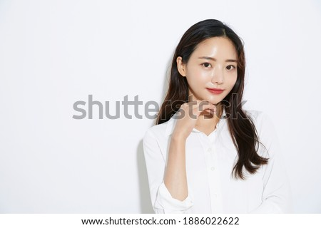 Business portrait of Asian young slender woman Royalty-Free Stock Photo #1886022622