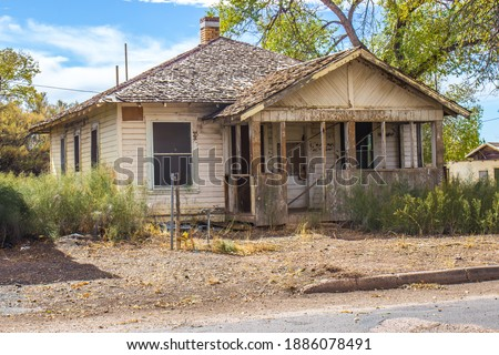 Old Abandoned One Level House In Disrepair Royalty-Free Stock Photo #1886078491