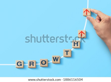 Wooden blocks arranged in curve shape with the word GROWTH. Business growth, career growth or growth concept. Royalty-Free Stock Photo #1886116504