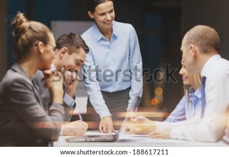 business, technology and office concept - smiling female boss talking to business team Royalty-Free Stock Photo #188617211