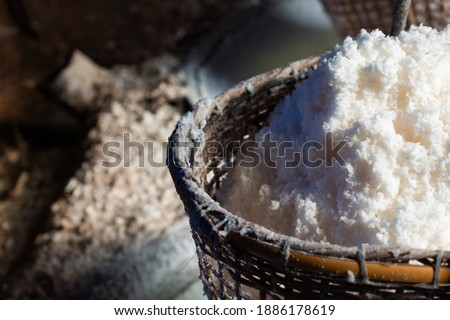 picture of production of natural rock salt by boiling saline from Sinthao salt pond in small village of Nan, Thailand