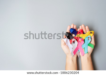 World cancer day (February 4). colorful awareness ribbons; blue, red, green, black, grey, white, pink and yellow color for supporting people living and illness. Healthcare and medical concept Royalty-Free Stock Photo #1886230204