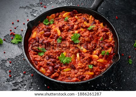 Vegetarian vegan mince chili con carne served in cast iron skillet pan.