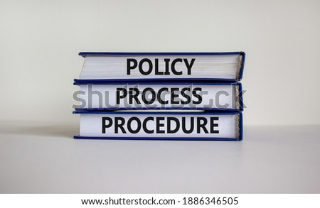 Policy, process, procedure symbol. Books with words 'Policy, process, procedure' on beautiful white table, white background. Business and policy, process, procedure concept, copy space. Royalty-Free Stock Photo #1886346505