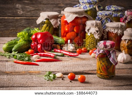Preserved and fresh vegetables on wooden background #188644073