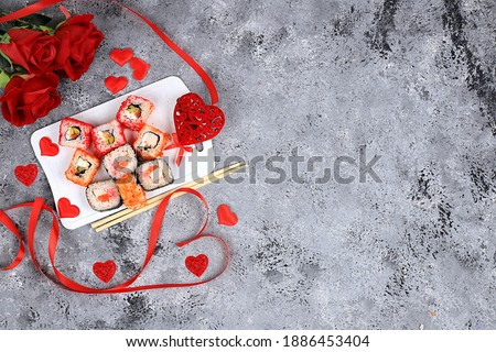 Heart of fresh sushi rolls with roses, valentine's day food, traditional japanese cuisine, place for text, top view, banner for shop advertisement or invitation