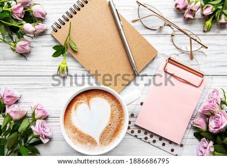 Workspace with diary, notebook, clipboard, roses on white background. Home office desk. Top view feminine background. Flat lay, top view. Royalty-Free Stock Photo #1886686795