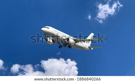 Zoom photo as seen from the ground of passenger airplane taking off in deep blue  slightly cloudy sky