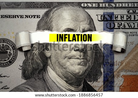 Torn bills revealing Inflation words. Idea for FED consider interest rate hike, world economics and inflation control, US dollar inflation Royalty-Free Stock Photo #1886856457