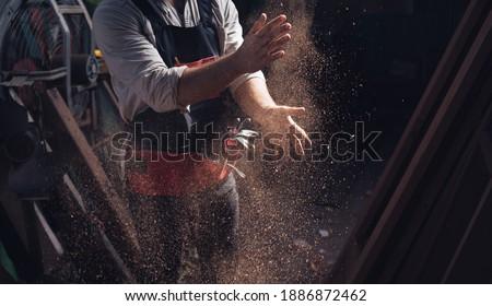 Woodworking carpenter furniture hand cuting.Man factory industry manufacturer, working workshop, maker construction. Skills artisan workshop factory. Royalty-Free Stock Photo #1886872462