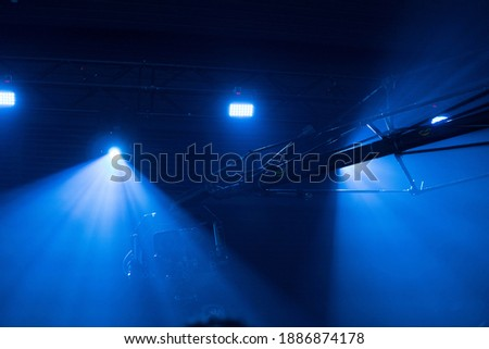Television camera on black background with blue lights. #1886874178