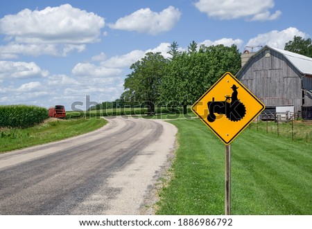 Farm Equipment Caution Sign:  A sign in southern Wisconsin alerts motorists to watch for farm machinery on the road ahead.